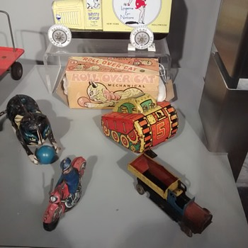 Tin Toys from a Welsh Tin making Musuem on display in their Cabinets not mine.