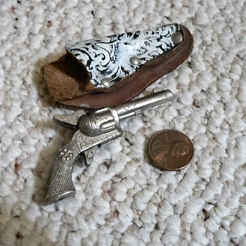 Minature cap pistol,, cast pot metal