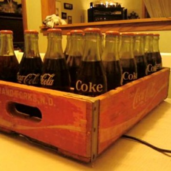 Unopened Coke bottles & crate