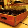 Unopened Coke bottles &amp; crate