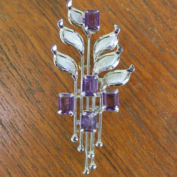 Silver and amethyst brooch