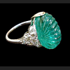Carved emerald, diamond and platinum ring