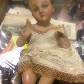 Very Old Wooden Baby with cloth dress & pink cheeks