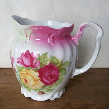 Antique Embossed Porcelain Milk Pitcher