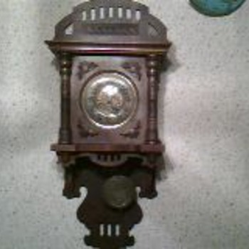 Antique? Wall clock.