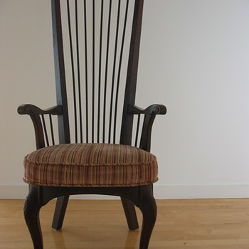 Carved wood highback chairs