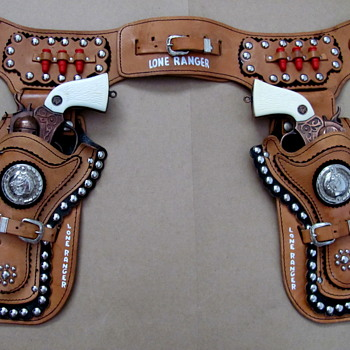 Beautiful double set of Esquire lone ranger guns and holsters one of my favourites  - Toys