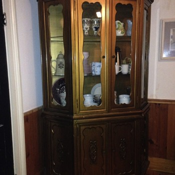 I wonder about this china cabinet's history...