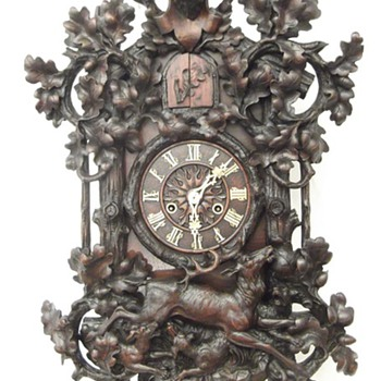 Magnificent carved (spring driven) wall cuckoo clock. WHAT A CARVING!  - Clocks