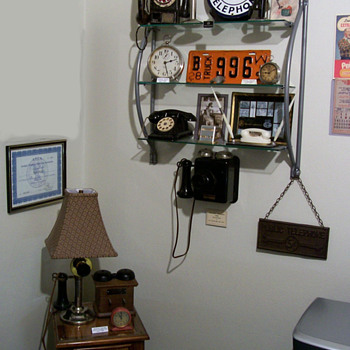 Some old toy phones on shelf... - Telephones