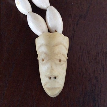 African face mask ivory necklace
