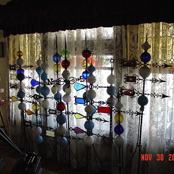 Lightning Rods...Weathervanes...Glass Balls...Roof Tops Were There Home For Many Years