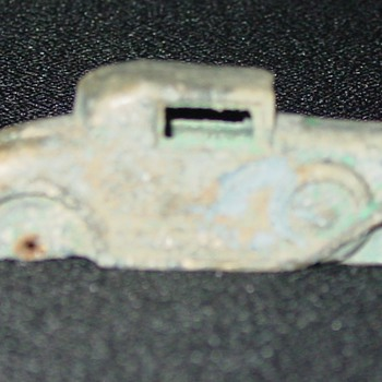 Small cast iron car - saved by its copper paint