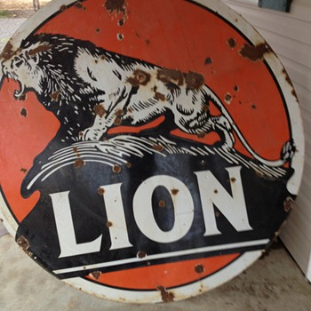 lion oil porcelain sign