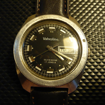 Crossover Vintage wristwatch 1970s with Valvoline In place of Brand  - Advertising