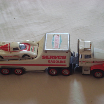 1989 servco gasoline toy truck with racing car ( original hess tire)