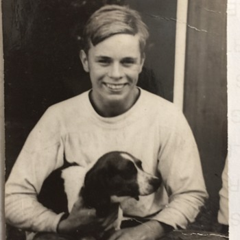 1950's  unknown Artist Photograph holding his Dog, a Spaniel