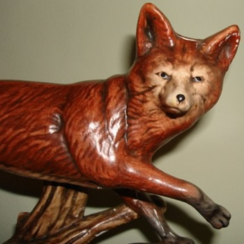 Fox on wooden plinth