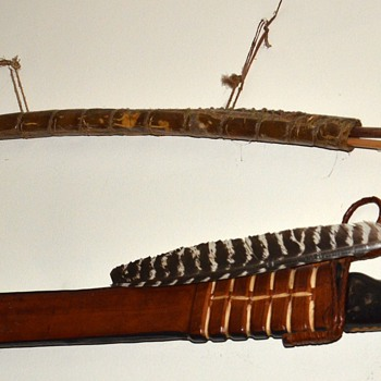 Poison Darts in a Crocodile Skin Quiver and an old Machete in a Decorated Leather Sheath
