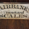 Late 1900s wooden Fairbanks Standard Scales sign