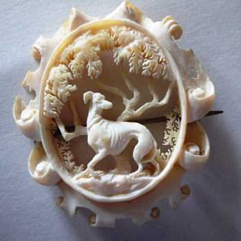 Hand-carved into a Gorgeous Scene with a Magnificient Greyhound Brooch from the late 1800's.