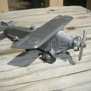 Kansas Toy & Novelty Co Army Air Corps Plane, anodized finsh with cast prop.