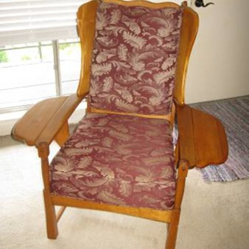 Vintage chair with fold down arms rests