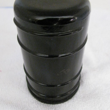 ANTIQUE BLACK THREADLESS GLASS INSULATOR &quot;WADE STYLE&quot;