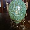 Vaseline Opalescent vase in brass stand
