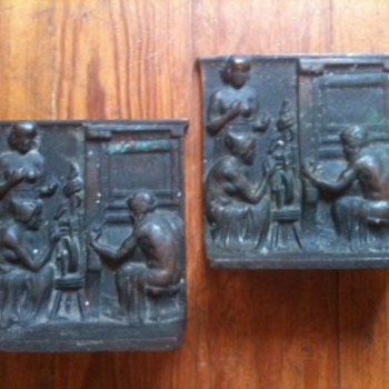 Is anyone familiar with the relief designs on these antique brass bookends?