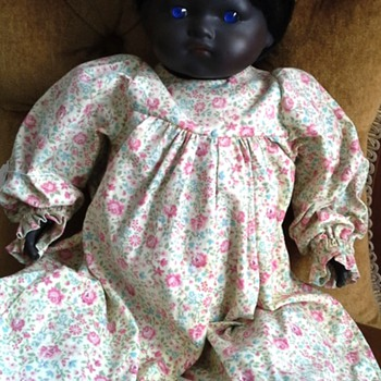 Black doll with blue eyes - Dolls