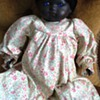 Black doll with blue eyes