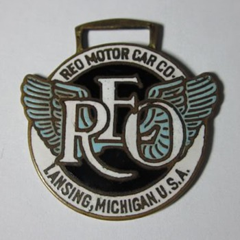 Early REO Motor Co. Enamel Watch Fob.
