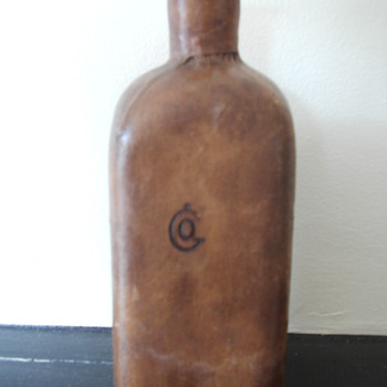 dark brown glass leather covered bottle