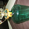antique green lock and key liquor bottle