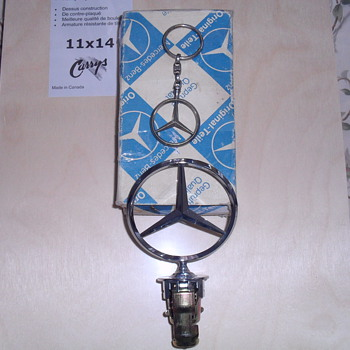 Mercedes Benz hood ornament and key chain.