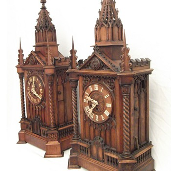 A pair of magnificent and exceptional Black forest automated monk and cuckoo clocks