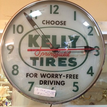 pam lighted Kelly tires clock