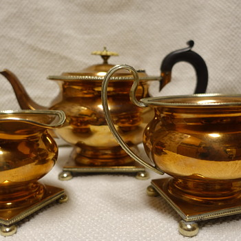 copper plate tea set with silver tone trim/square base