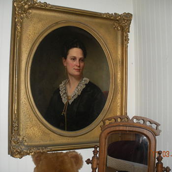 Painting of May F Kingsley in a gold frame
