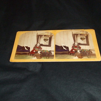 Handtinted stereoview of girl with toys and bird