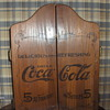A wooden cabnet from I don't know where.Coca Cola