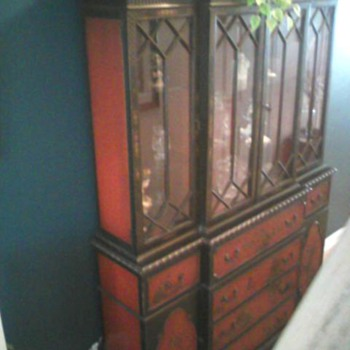 Breakfront, hand painted oriental. Also has a pull out secretaryal desk.