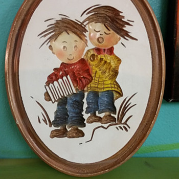Children singing plaques