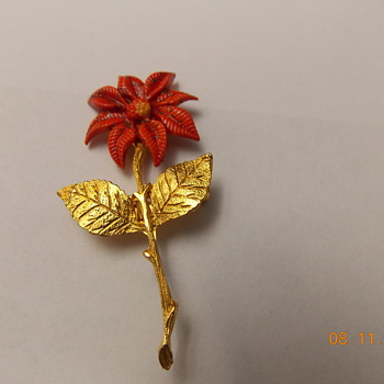Rose pin with religious symbol on back