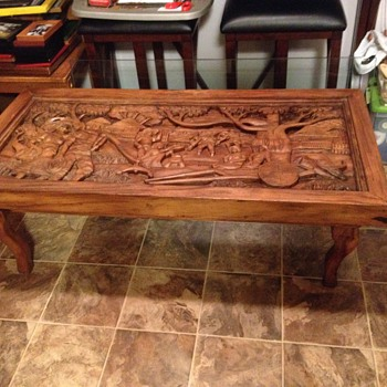 I would love to know anything I can about this coffee table. I believe it is an antique an made from teek wood. - Furniture