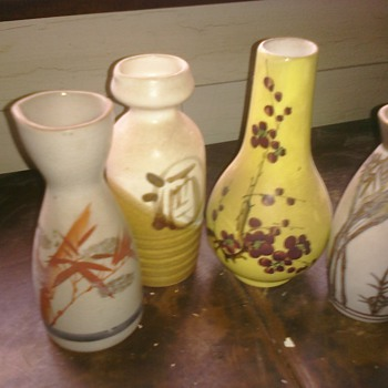 I believe these are Saki vases