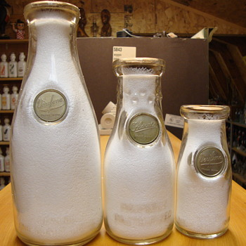 Three Token Milk Bottles.....