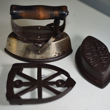 Early 1900's Sad Irons, carrier and Trivet