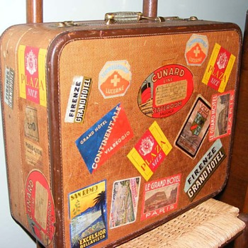 Old suitcase covered in luggage labels from all over Europe - Accessories